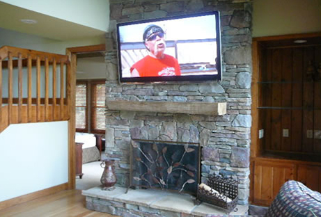Sixty five inch TV over fireplace
